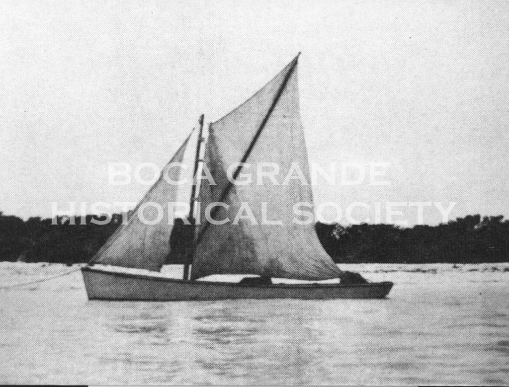 Sailing sharpie with mullet net in the back, ca  1910