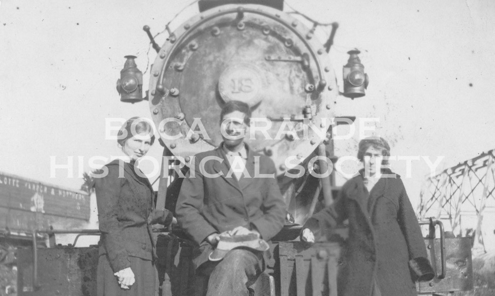 Boca Grande Railroad: Three people posing in front of a train