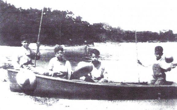 4 boys on boat fishing