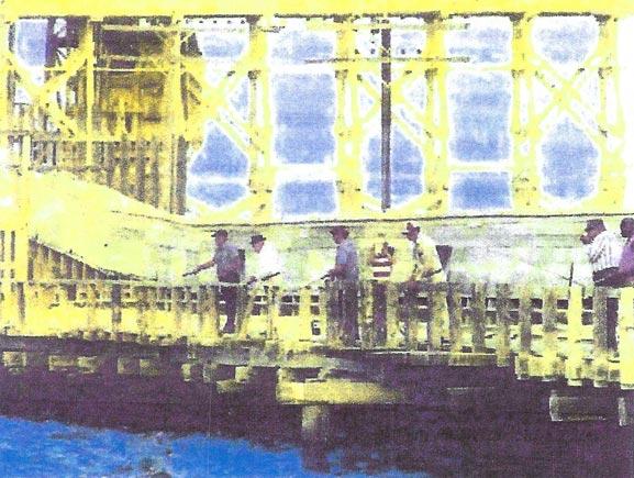 Phosphate Dock - men standing on bridge