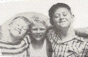 black and white photo of three boys