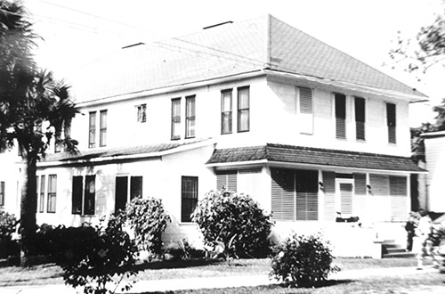 two-story white building