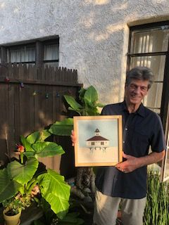 David Futch holding painting of the Boca Grande Lighthouse